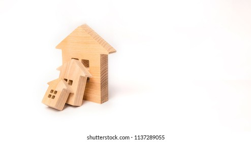 Small wooden houses fall on the big house as a domino. The concept of buying real estate. Insurance and investment risk. Falling prices in the real estate market. Growth in demand. Catastrophe.