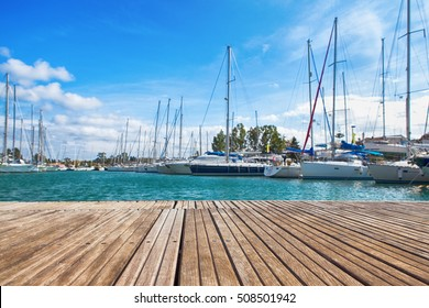 small wooden jetty in the background the port yacht