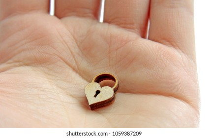 small wooden lock in hand on isolated background