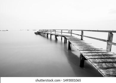 A small wooden pier heads into the distance on a calm morning in Sorrento, Mornington Peninsula, Australia.