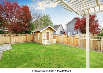 Small wooden shed in the back yard of American house. Northwest, USA