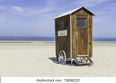 Small wooden 'Umkleide' - German for locker room - on wheels. Mobile dressing cabin on the beach.