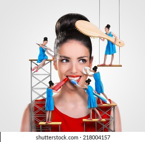 Small workers working on a beautiful woman