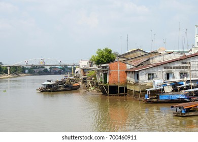 Small Working boats on the banks of the  Mekong River,  Vietnam