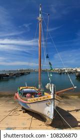 Small yacht  in Portimao harbor in Algarve, Portugal
