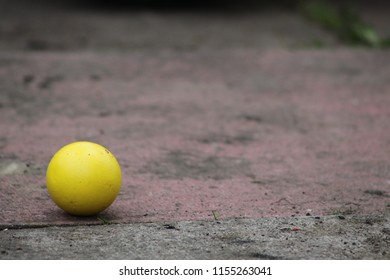 small yellow ball
