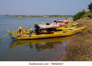 Small yellow boats for tourists on Mekong River,  Cambodia