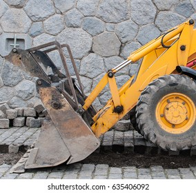 Small yellow excavator