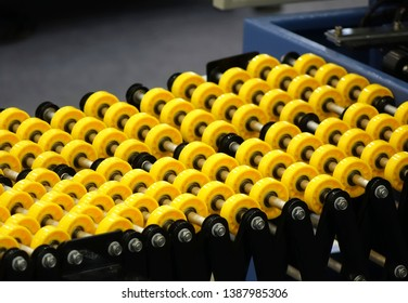 Small yellow plastic rollers for transporting goods