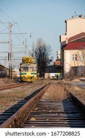 Small yellow train for track maintenance in Nymburk, Czechia
