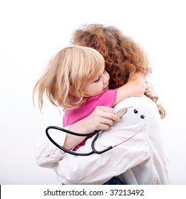 small young girl hugging woman doctor