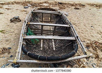 Smaller Bamboo Basket Boat on the village beach of Halong Bay. Asia, float Vietnam.