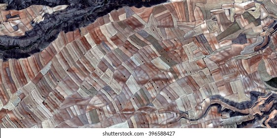 smallholding,allegory, tribute to Picasso, abstract photography of the Spain fields from the air, aerial view, representation of human labor camps, abstract, cubism, abstract naturalism,