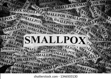 Smallpox. Torn pieces of paper with the words Smallpox. Concept image. Black and White. Close up.
