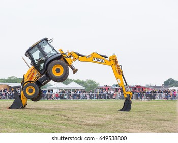 SMALLWOOD, CHESHIRE -  MAY 29th 2017: Dancing JCB digger putting on a show at smallwood Vintage Rally, UK MAY 29th, 2017