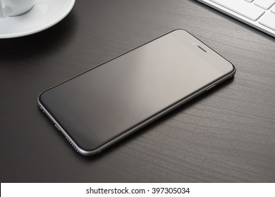 Smarphone on a dark table in the office, close-up