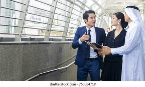 Smart asian arab business people man and woman worker talk and joy together in the situation of look forward future idea at the pedestrian walkway