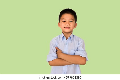 Smart Asian boy isolated on green background.