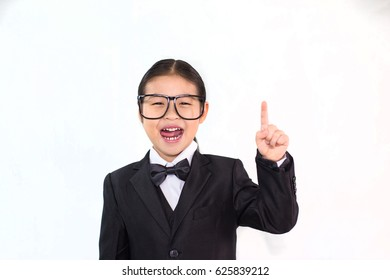 Smart asian girl wearing glasses who smiling and point finger on white background isolated