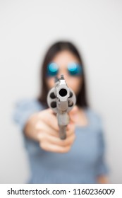 Smart asian women pointing revolver gun to audience, Crime concept