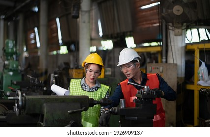 Smart asian Worker factory concept. Inspection technician, factory engineer, inspection of the machine condition in the factory. Inspection by technicians, industrial business, production machinery