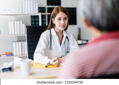 smart and attractive asian woman doctor explain and discuss with old asian man for consult clinic background health concept