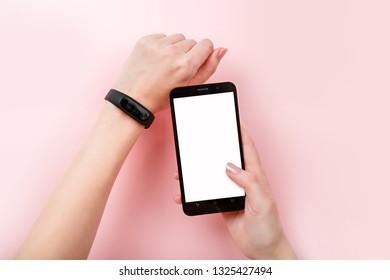 Smart Band App Mobile Phone Sport bracelet and smartphone with white screen mock up. Fitness band run tracker on woman's hand. wristband with running activity steps counter and heartbeat pulse meter
