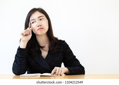 Smart and beautiful Asian business women in the black suit thinking about planning, concept of smart women CEO in the future.