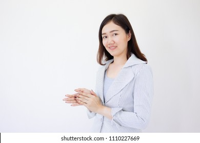 Smart and beautiful Asian business women age between 26-30 years old clapping, close up haft body on white background.