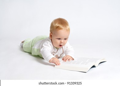 smart blond baby reading a book