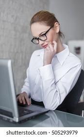 Smart blonde woman online flirt during work time in office
