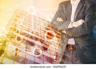 Smart Building and Internet of Things concept. Double exposure of Business man standing, office building and abstract digital connection background.