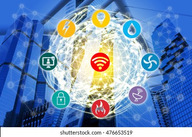 Smart Building and Internet of Things concept. Smart building management icons on office building and wireframe world connect with abstract digital connection background.