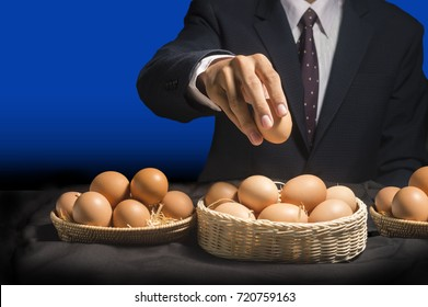 smart business man allocate egg into many baskets . do not put all eggs in one basket