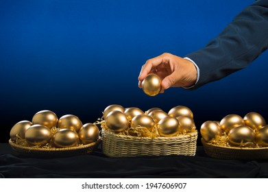 smart business man hand allocate golden egg into many baskets. do not put all eggs in one basket. has very good return on investment in each buiness