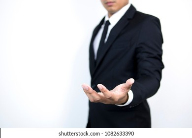 Smart Business man use hand to Hold something on white background