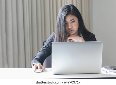 smart business woman have a headache be serious from she work hard on laptop long times
