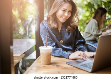 Smart business woman is working with computer