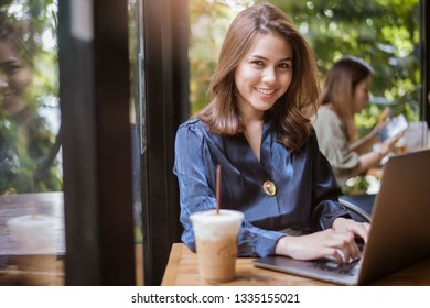 Smart business woman is working with computer  - Shutterstock ID 1335155021
