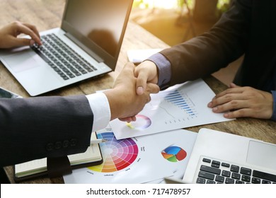 smart businessman hand hold together,Business handshake and business people. Business handshake for closing the deal after singing the lucrative contract between companies.Trust business partner vat