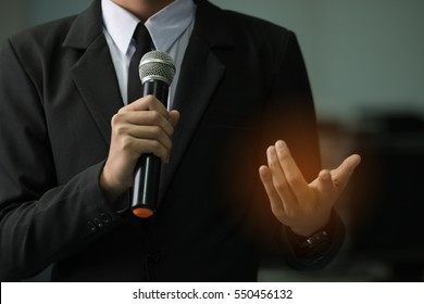 smart businessman speech concept, talking with microphone in conference hall