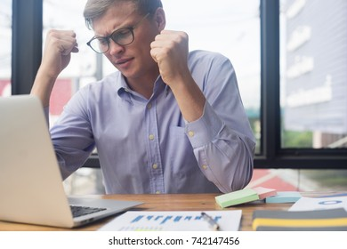 smart businessman at workplace tired and worried in office ,business concept