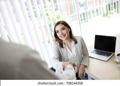 Smart Businesswoman handshake for closing the deal with business people team happy good success result in office concept background. Participate staff. Europe and European people