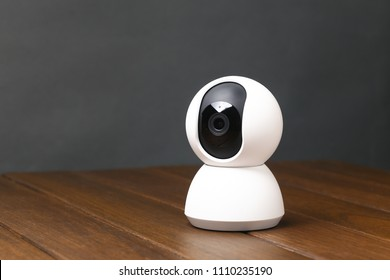 smart camera on wooden table