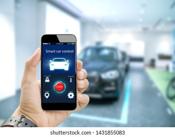 Smart car control appliction concept.Hands holding mobile phone on blurred car as background