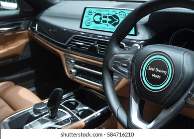 Smart car (HUD) concept. Empty cockpit in vehicle and Self-Driving mode car screen .