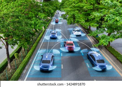 Smart cars with automatic sensor driving on green road with wireless connection
