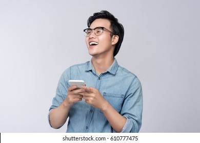 Smart casual asian man using smartphone in studio background