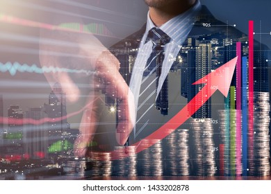 smart caucasian businessman  double exposure with downtown city building and hand finger walk on coin money stack with virtual financial grpah chart business finance ideas concpt