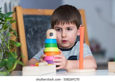 Smart child plays with didactic toys